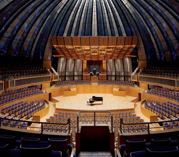 Stainless steel Omega 1540 bronze metal mesh encases sound deflection elements which direct the sound into the dome of this famous concert hall. Tonhalle Dusseldorf Germany